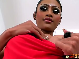 Beautiful ladyboy shows off nice round boobs and giant cock
