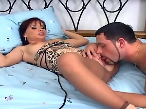 Redheaded cutie in ripped up nude pantyhose fucking and footjob on a bed